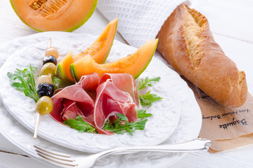 Ham with melon and olives