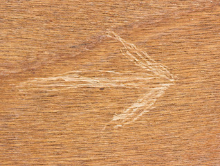 Arrow marks on wood.