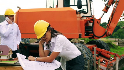 Woman looking on the project on the construction site