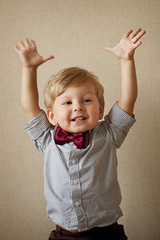 Happy handsome little boy in a bow tie
