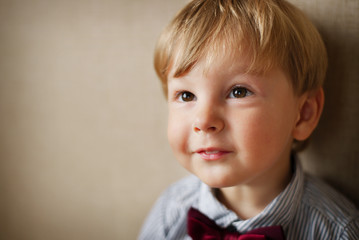 Portrait of Young Boy Wearing Bow Tie