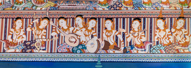 Native Thai mural painting on temple wall, Thailand