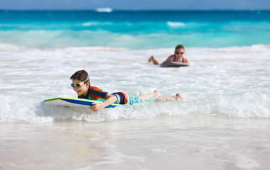 Mother and son surfing
