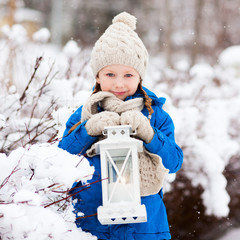 Little girl with Christmas lantern