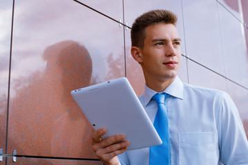 Smiling Businessman Holding Tablet Computer