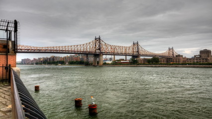 The Queensboro Bridge with boats on the East River