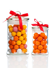 Colorful background of assorted Gumballs in  glass jar,  isolate