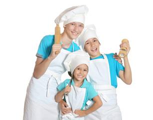 Little children in chef uniforms