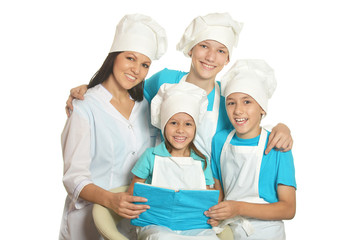 Happy chef with assistants