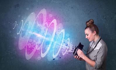 Photographer girl making photos with powerful light beam