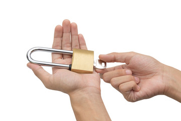 Hand holding, locking and unlocking brass padlock isolated over