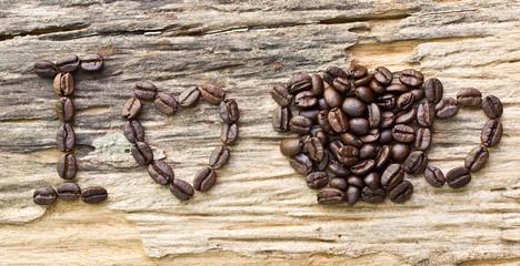 I love coffee made form coffee bean on wood background..