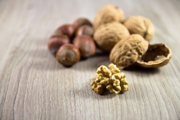 Mix of nuts on a wooden background