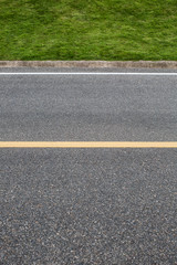 Asphalt road with marking lines. Close-up background texture wit