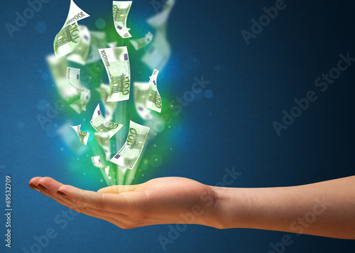 canvas print picture Glowing money in the hand of a woman