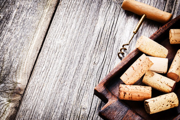 Bunch of wine corks and corkscrew