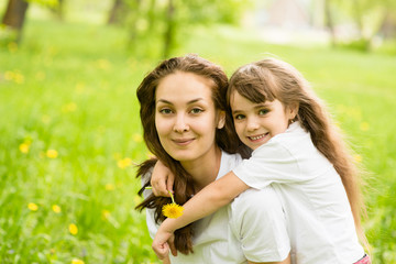 young girl with mother in park