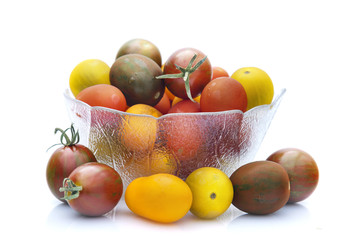 Assorted cherry tomatoes isolated on white