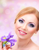 Beautiful young woman with glamour make up and flower ob bright
