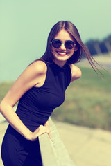 Happy smiling woman in sunglasses
