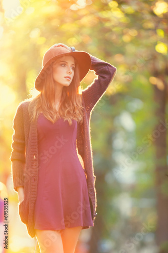 canvas print picture Redhead girl in hat in the autumn park.