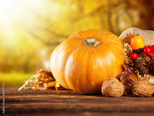 canvas print picture Autumn colored pumpkins on wooden table