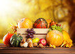 Autumn fruit and vegetable in wooden box