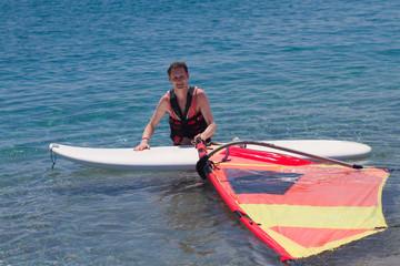 Mature adult windsurfing