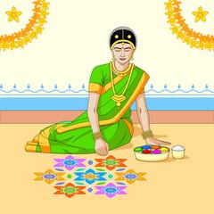 Woman making rangoli for Indian festival