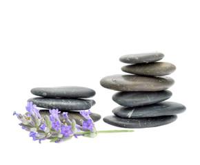 Santorini volcanic pebbles and a lavender flower.