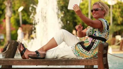 attractive blonde women taking self portrait in the park