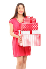 Young woman holding a bunch of presents