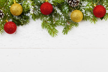 Christmas decoration on the wooden white background with snow or