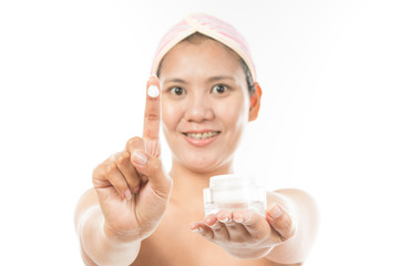 woman with cosmetic cream present..