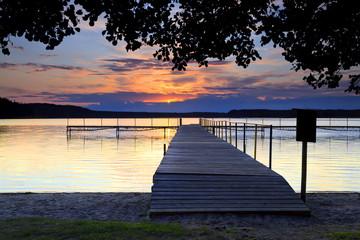 The platform on Kashubian lake at sunset