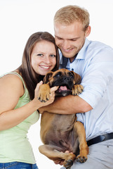 Portrait of a Happy Young Couple with a Dog.
