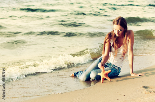 canvas print picture beautiful girl on beach