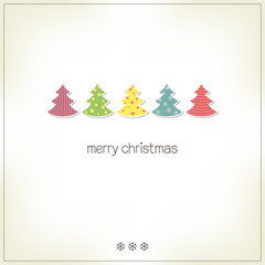 Greeting card wit Christmas trees in paper cutout style