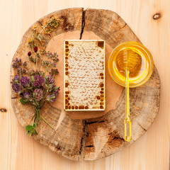 Honey comb, honey and dried herbs