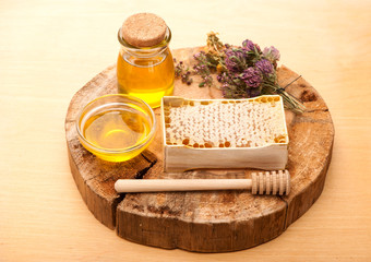 Honey, honey comb and dried herbs