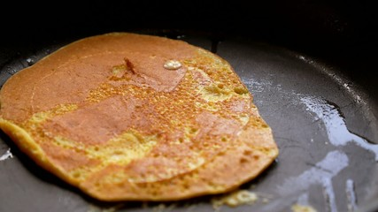 Closeup of Making Griddle Cakes or Pancakes on a Hot Griddle.
