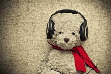 retro bear listening to music on headphones