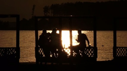 Stock Video Footage Party at sunset by the lake in the gazebo