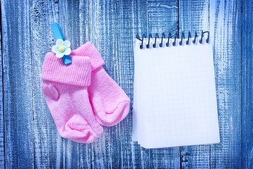 note and baby socks