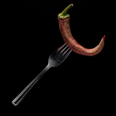 Red Paprika Pepper On A Fork