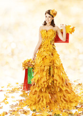 Shopping Woman Happy In Autumn Fashion Dress Of Fall Leaves