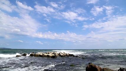 Crashing waves on  the rocky beach