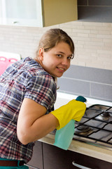 Young girl cleaning in the kitchen