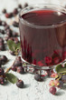Compote of berries irgi in a glass   and berries irgi   on the t