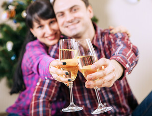 Close up image couple hands with bubble wine goblets
